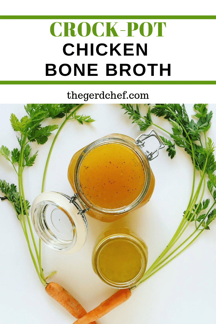 2 jars of homemade crock-pot chicken bone broth, surrounded by fresh carrots