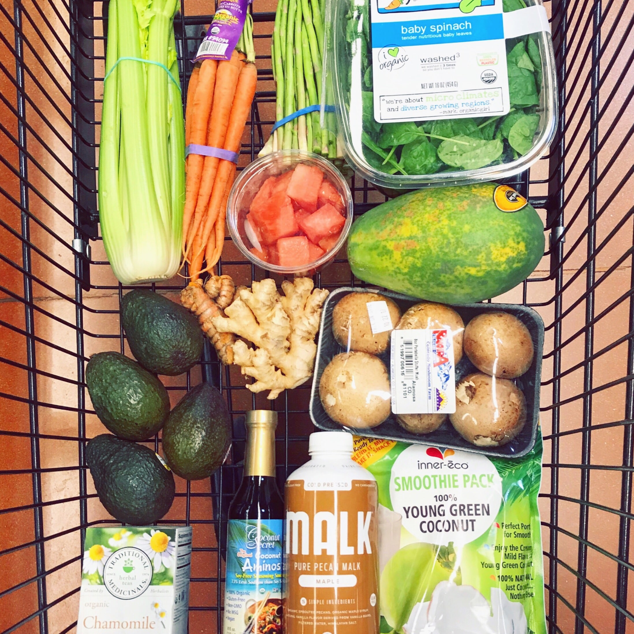 shopping cart full of healthy food