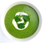 Bowl of green zucchini watercress soup