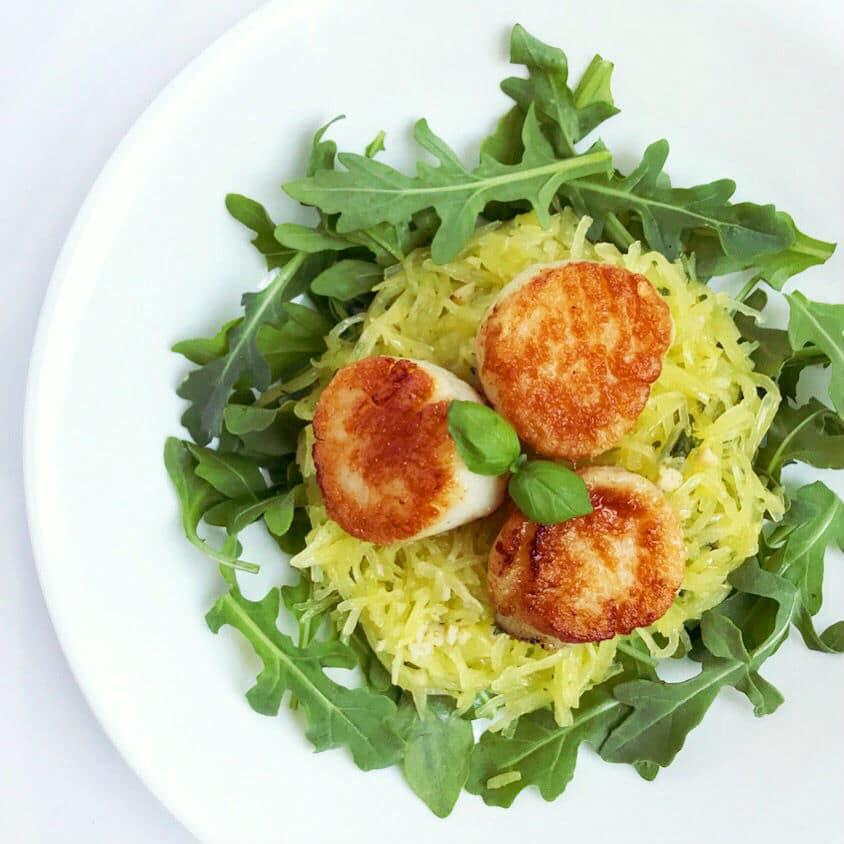 Seared scallops with spaghetti squash and fresh arugala.