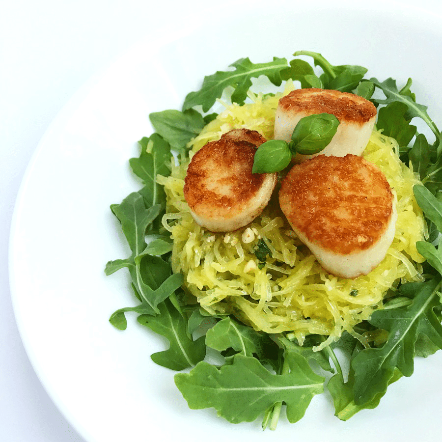 Seared scallops with spaghetti squash and fresh arugala.