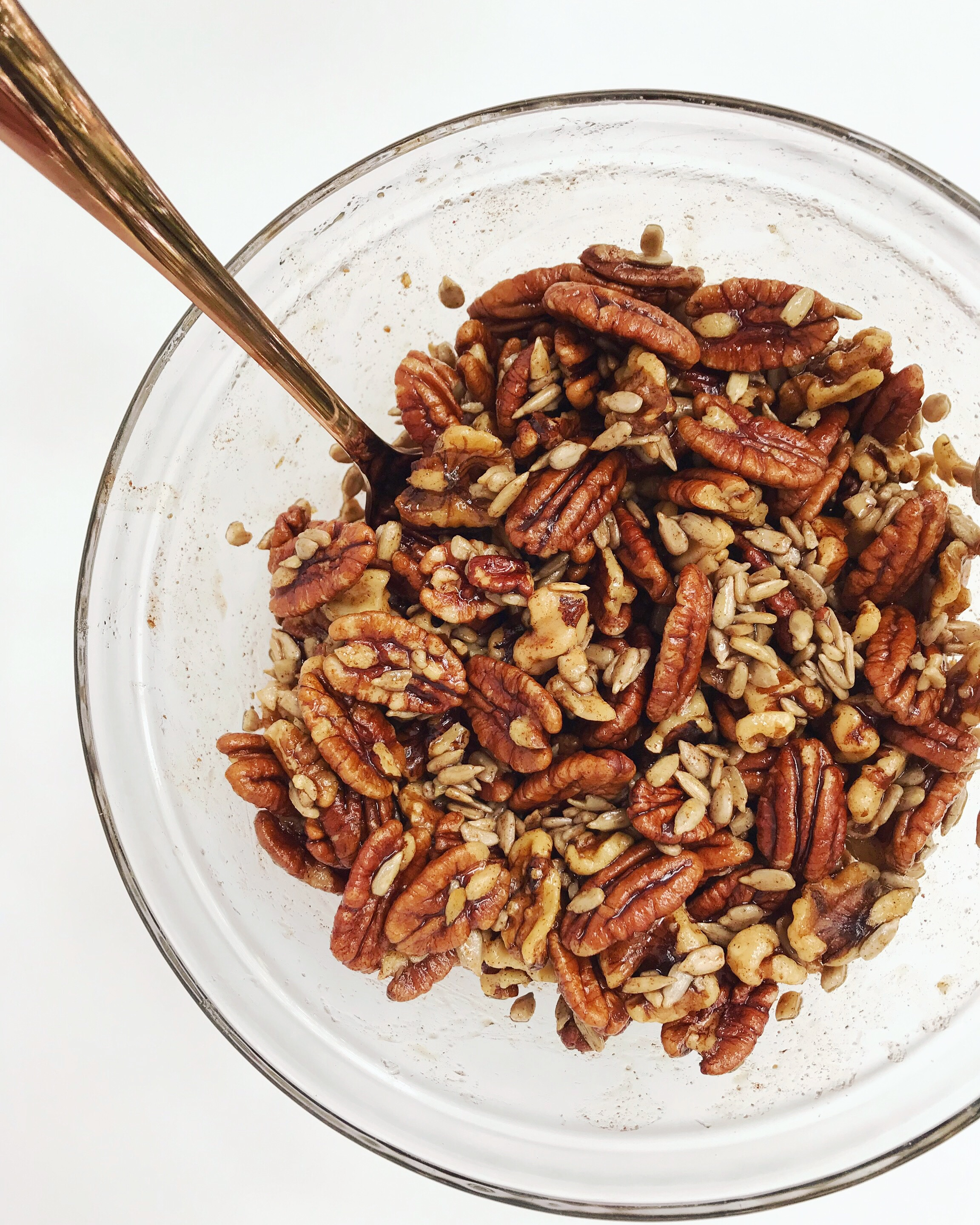 Mixing bowl full of pecans, walnuts, and sunflower seeds.